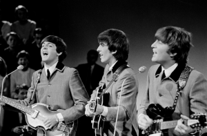 McCartney, Harrison and Lennon perform on Dutch television in 1964 (by Omroepvereniging VARA).