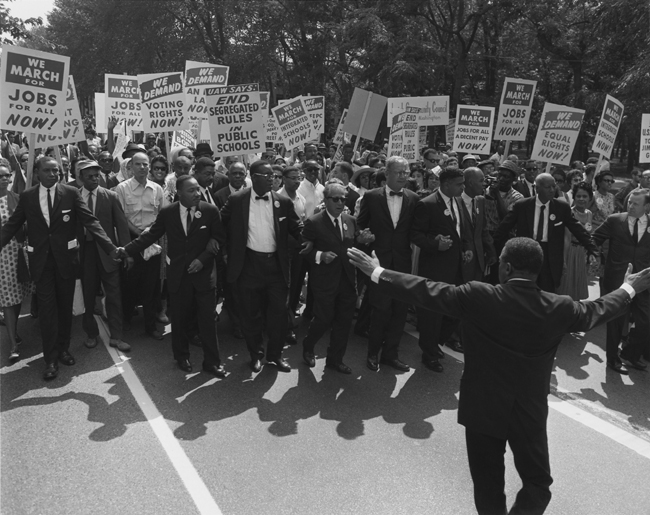 Jewish civil rights activist Joseph L. Rauh marching with Martin Luther King, Jr. in 1963 (United States Information Agency/Wikimedia).