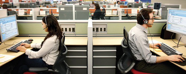 Two agents in a contact center (Diana Varisova/Wikimedia).